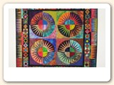 "Here is a picture of my quilt ""Fireworks"" on the Hang it Dang it. The wall hanging is 51"" x 51"".  I love the way it hangs and the Hang it Dang it was so easy to use. I will be ordering more of them.  Your company was very prompt in sending it and it was in excellent condition.